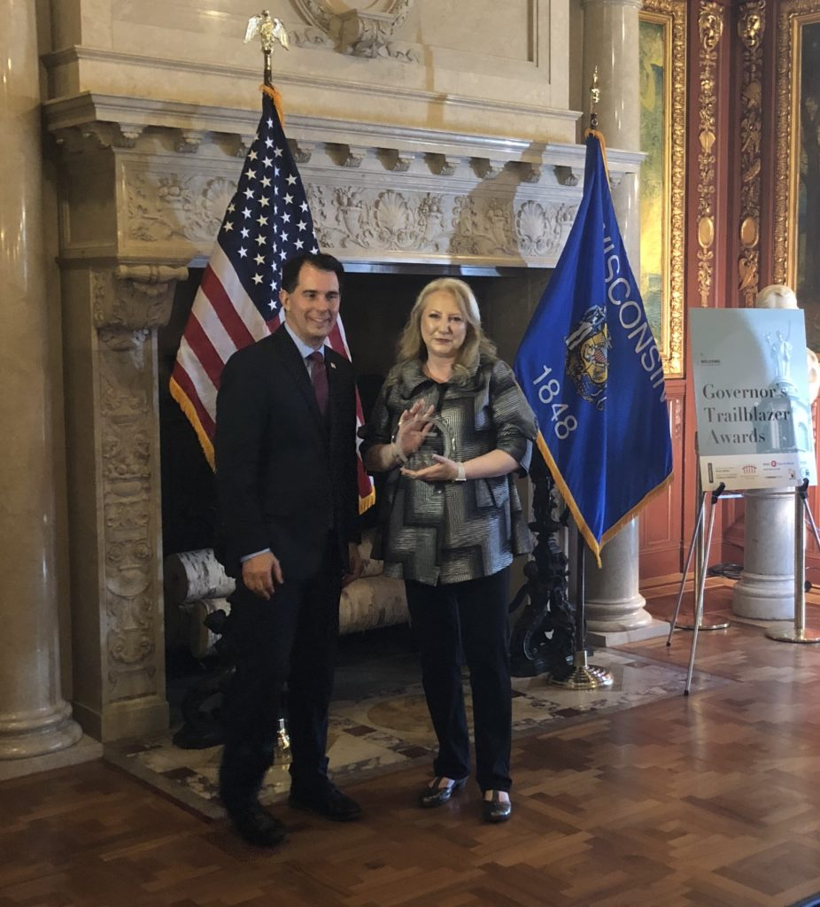 Charlene Blohm with Governor Scott Walker at the 2018 Governor's Trailblazer Award for Wisconsin Women in Business ceremony.